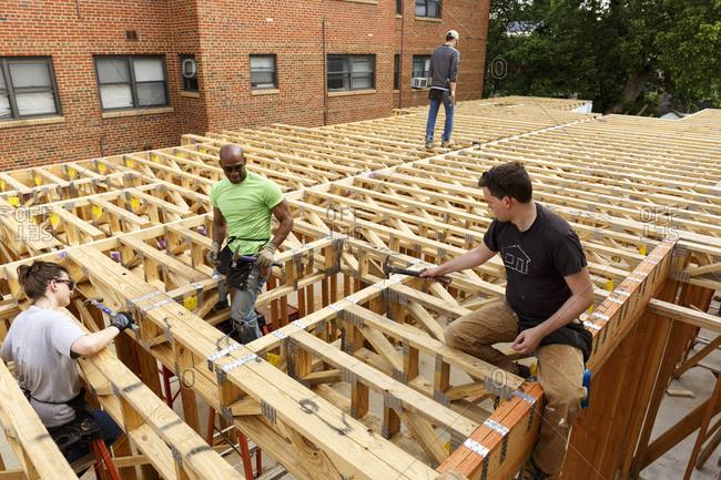 Volunteers hammering at construction site