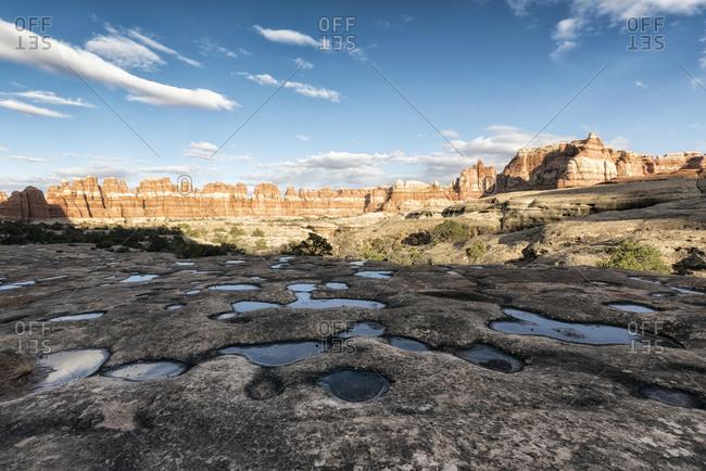 Puddles in desert, Moab, Utah, United States