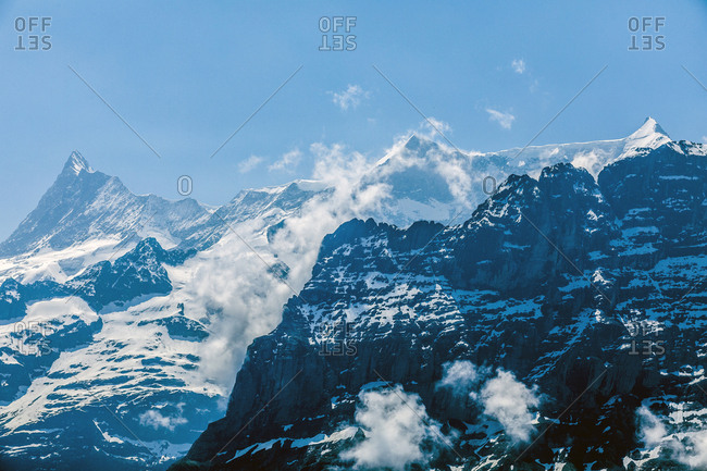 Clouds on snowy mountains
