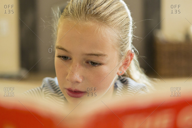 Close up of Caucasian girl reading book