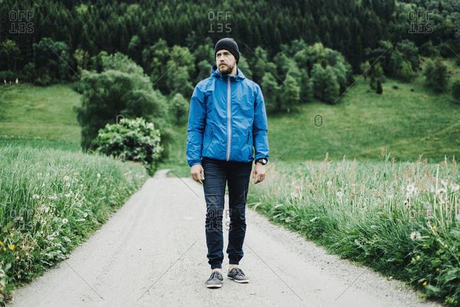 Caucasian man standing on dirt path