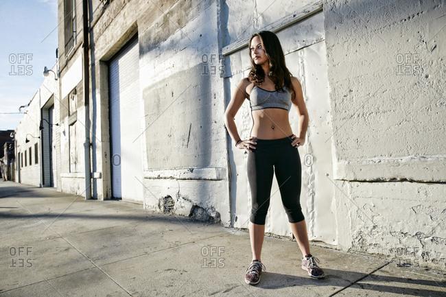 Mixed race woman standing on sidewalk