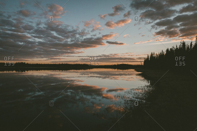 Reflection of clouds in water at sunset