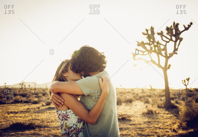 Hispanic couple kissing in the desert