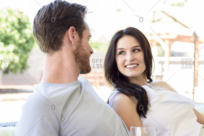 Caucasian couple relaxing and smiling