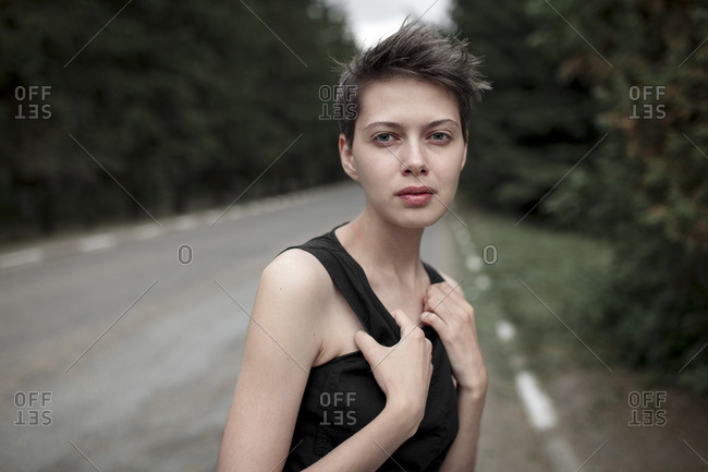 Serious Caucasian woman standing in road