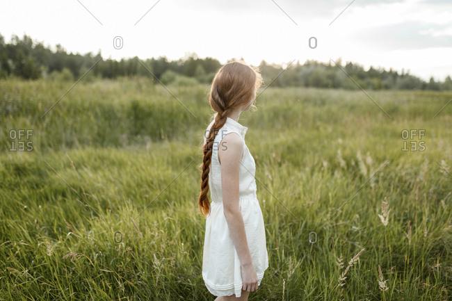 Caucasian girl standing in field