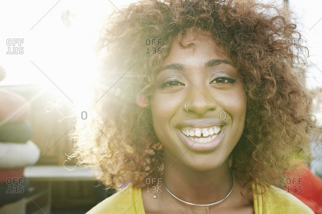 Sun beams on face of smiling black woman