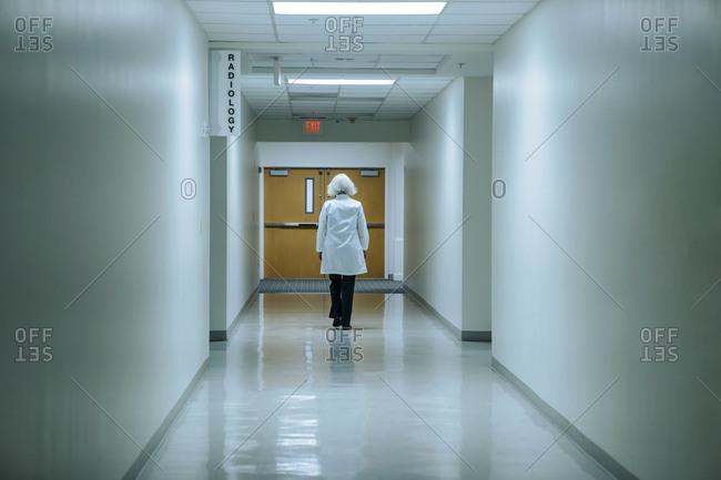 Caucasian doctor walking in hospital