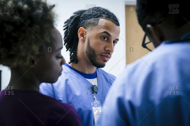 Serious nurses talking
