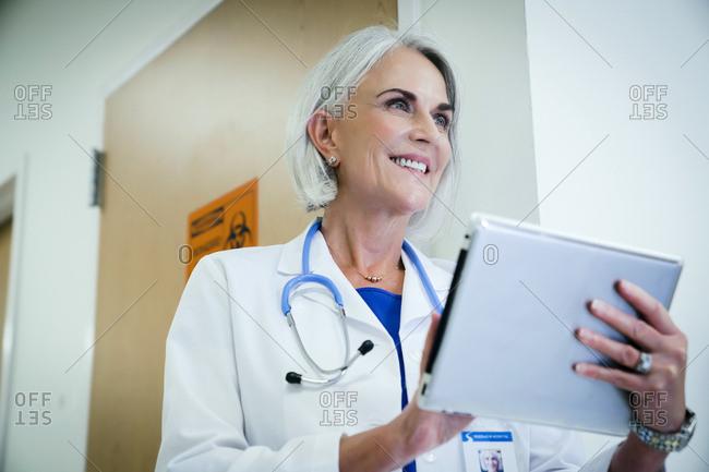 Caucasian doctor using digital tablet