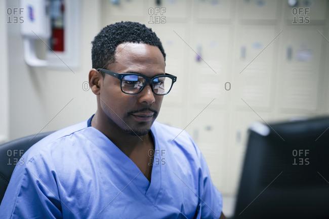 Black nurse using computer