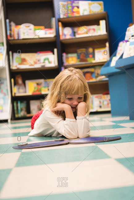 Girl reading a book in book store