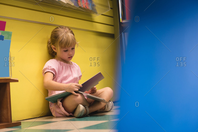 Innocent girl reading a book