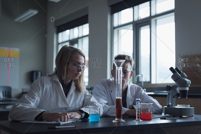 University students in chemical experiment at laboratory
