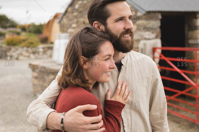 Affectionate couple embracing each other at countryside