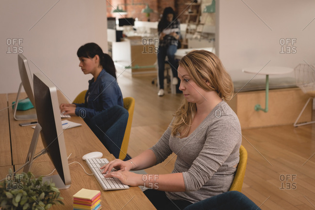 Female executives working on computer in the creative office