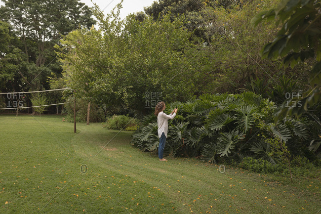 Woman checking the plants in garden