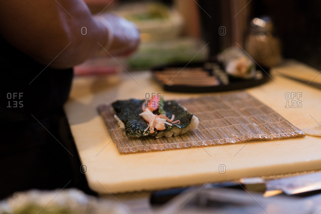 Unrolled sushi kept on a table in a restaurant