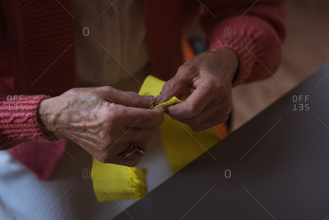 Senior woman doing craft work at nursing home