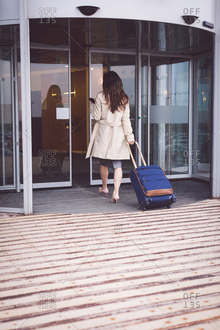 Rear view of businesswoman arriving in hotel