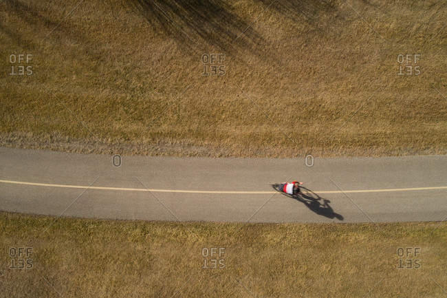 Aerial view of rider riding bicycle on road