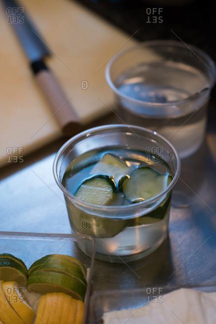 Sliced cucumber dipped in vinegar in a kitchen restaurant