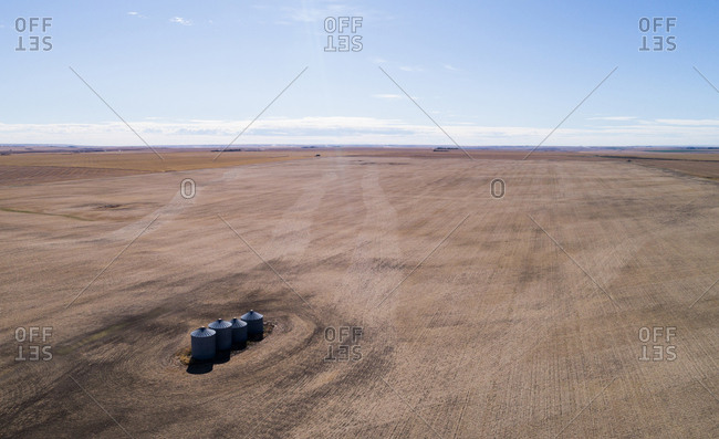 Aerial of containers in field on sunny day