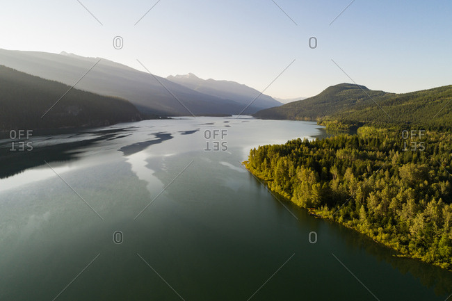 Scenic view of river passing through forest and mountains