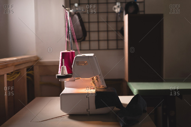 Sewing machine on table in designers studio
