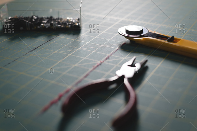 Close-up pliers and blade on table