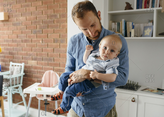 Dad holds his son in his arms