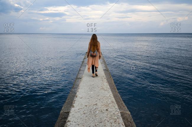 Tourist walks a pier, Crimean peninsula
