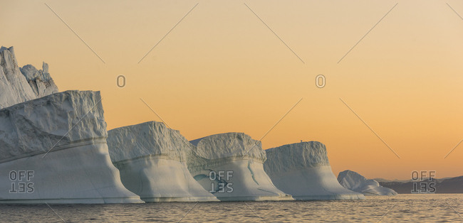 Icebergs in Greenland at sunset in Scoresby Sound