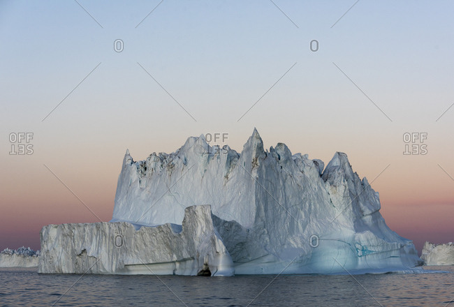 Sunset over icebergs in Scoresby Sound, Greenland