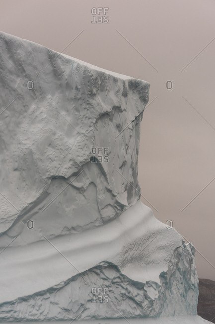 Snow-covered iceberg abstract in Scoresby Sound, Greenland