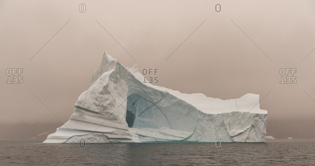 Foggy sunset over icebergs in Scoresby Sound, Greenland