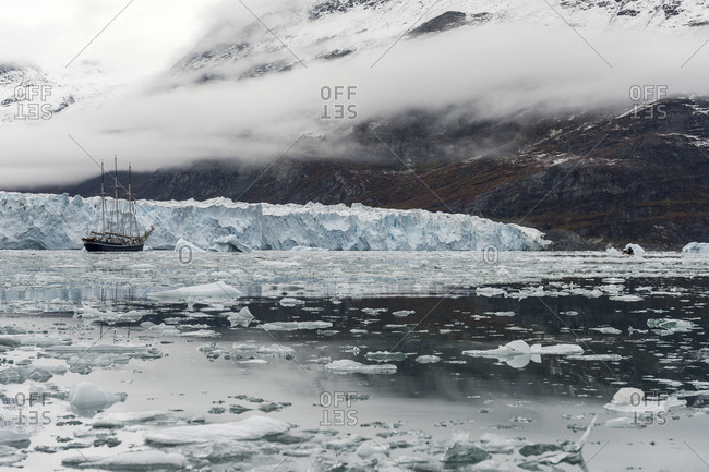 Sailboat in icy waters of Scoresby Sound in Greenland