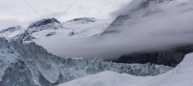 Foggy mountains and icebergs in Greenland
