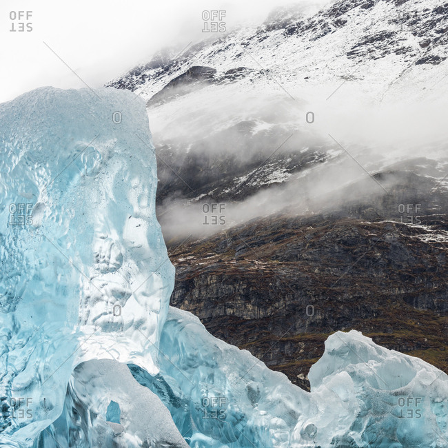 Icebergs beside snowy mountains in Greenland in Scoresby Sound