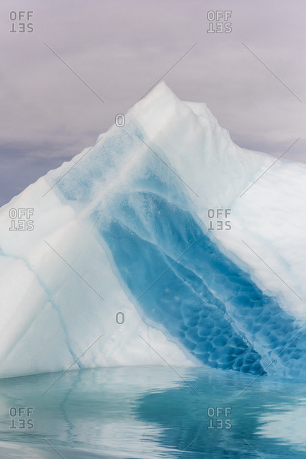 Blue and white icebergs in Greenland in Scoresby Sound
