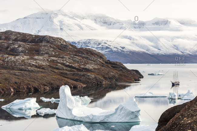 Sailboat sailing in icy waters of Scoresby Sound in Greenland