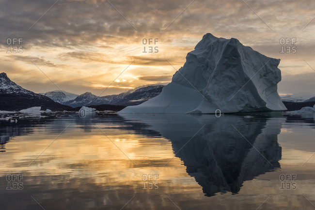 Sunset over icebergs in Scoresby Sound in Greenland