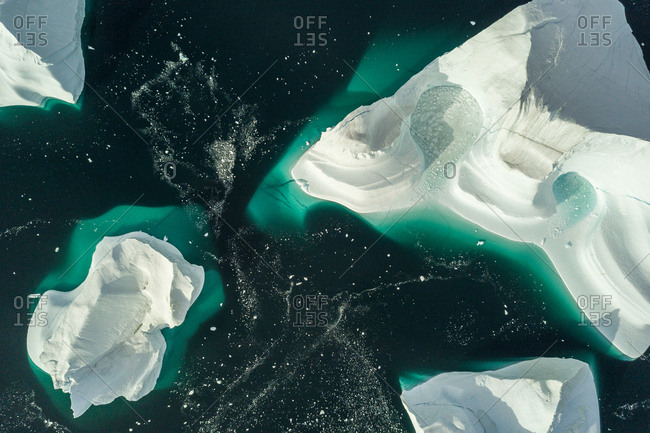 Aerial view of icebergs in Greenland in the Scoresby Sound