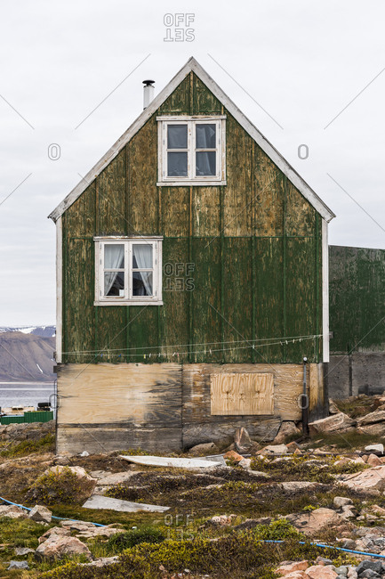 Green cottage in a village in Greenland