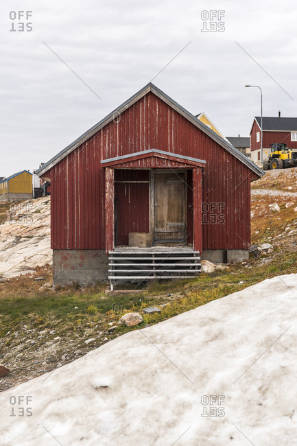 Greenland - September 11, 2017: Red cottage in a village in Greenland