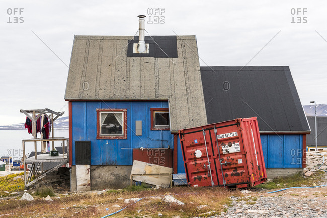 Greenland - September 11, 2017: Blue cottage in a waterfront village in Greenland