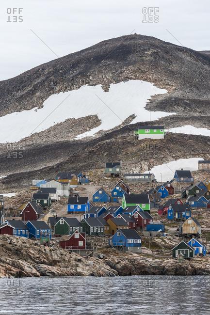 Greenland - September 11, 2017: Colorful hillside cottages in a village in Greenland