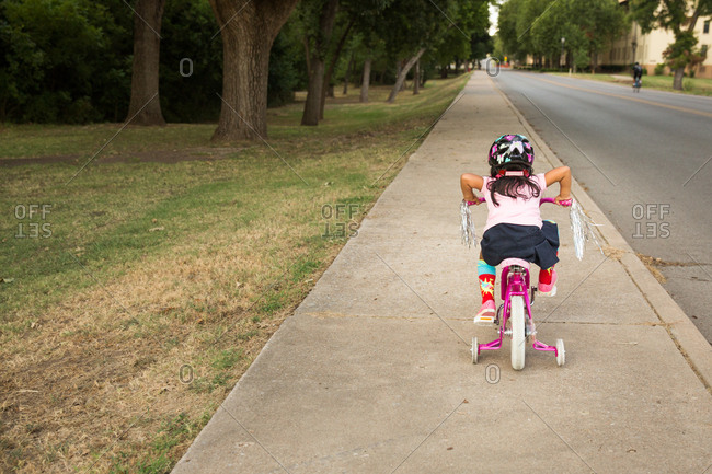 Little girl learning how to ride bike