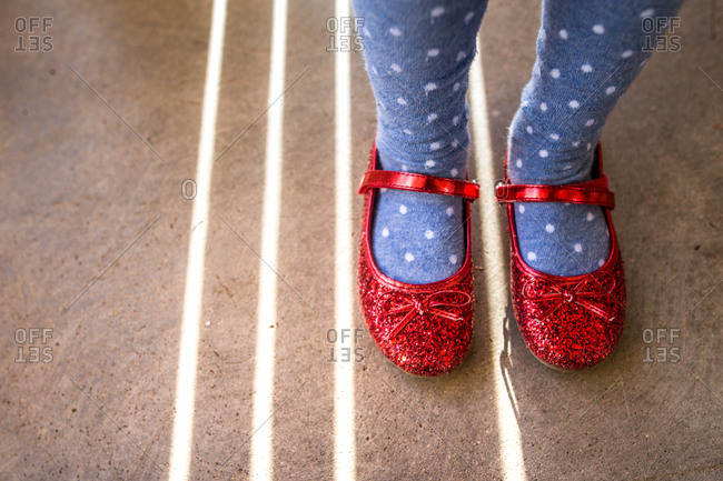 Close-up of fashionable red sparkle slippers